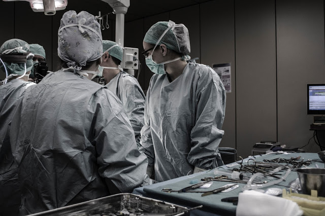 Photo of a group of doctors in an operating room.