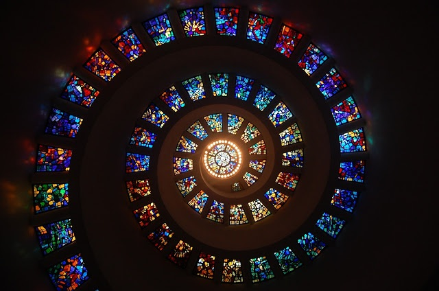 A spiral of stained glass windows