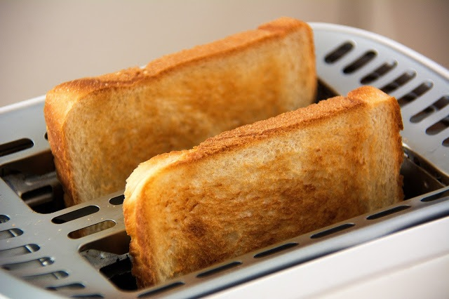 Picture of two slices of toast in a toaster