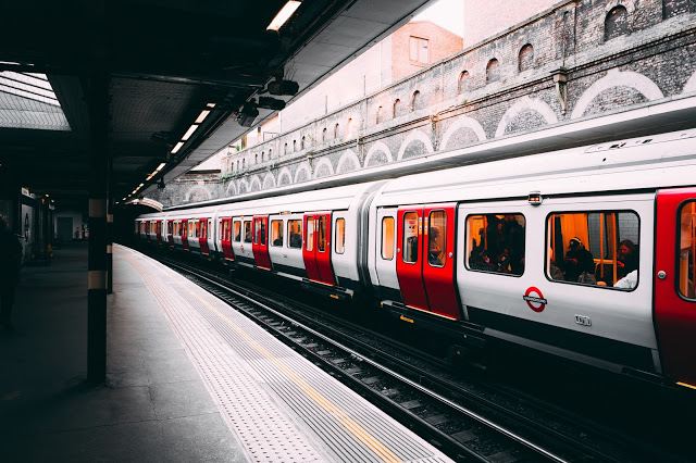 Photo of a train at a station platform.