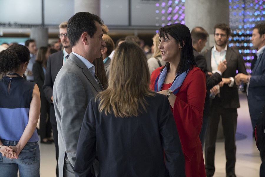 PHOTO 4: Our CEO Elena Gil, conversing with the attendees during the cocktail