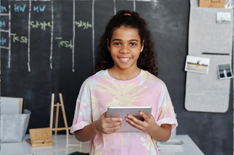 Young Student Holding iPad